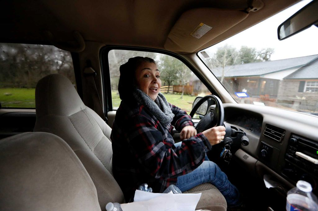 Rowdy Girl Sanctuary founder Renee King-Sonnen drives through her farm Tuesday, Jan. 26, 2016, in Angleton. The vegan farm sanctuary is run by King-Sonnen, who recently bought a herd of cattle from her husband in an effort to rescue the cows from slaughter. Now, the sanctuary is home to 48 cows, 7 chicken, a turkey, 4 horses and 4 pigs, who get to stay on the 96-acre lot in a sort of spa-retirement setting. While some of the cows were rescued locally, including the many from her husband's herd, there are new additions coming in from as far away as Florida, as King-Sonnen works to disrupt the traditional farming system that she feels is cruel to animals. ( Steve Gonzales / Houston Chronicle )