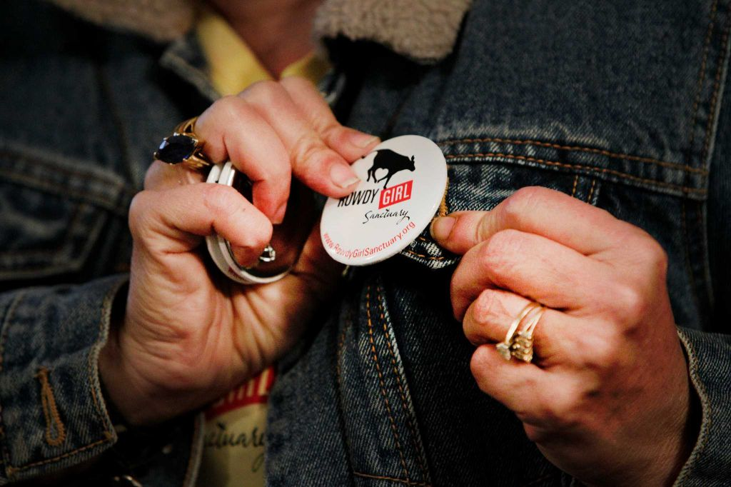 Rowdy Girl Sanctuary founder Renee King-Sonnen puts a logo pin on her jean jacket Tuesday, Jan. 26, 2016, in Angleton. The vegan farm sanctuary is run by King-Sonnen, who recently bought a herd of cattle from her husband in an effort to rescue the cows from slaughter. Now, the sanctuary is home to 48 cows, 7 chicken, a turkey, 4 horses and 4 pigs, who get to stay on the 96-acre lot in a sort of spa-retirement setting. While some of the cows were rescued locally, including the many from her husband's herd, there are new additions coming in from as far away as Florida, as King-Sonnen works to disrupt the traditional farming system that she feels is cruel to animals. ( Steve Gonzales / Houston Chronicle )