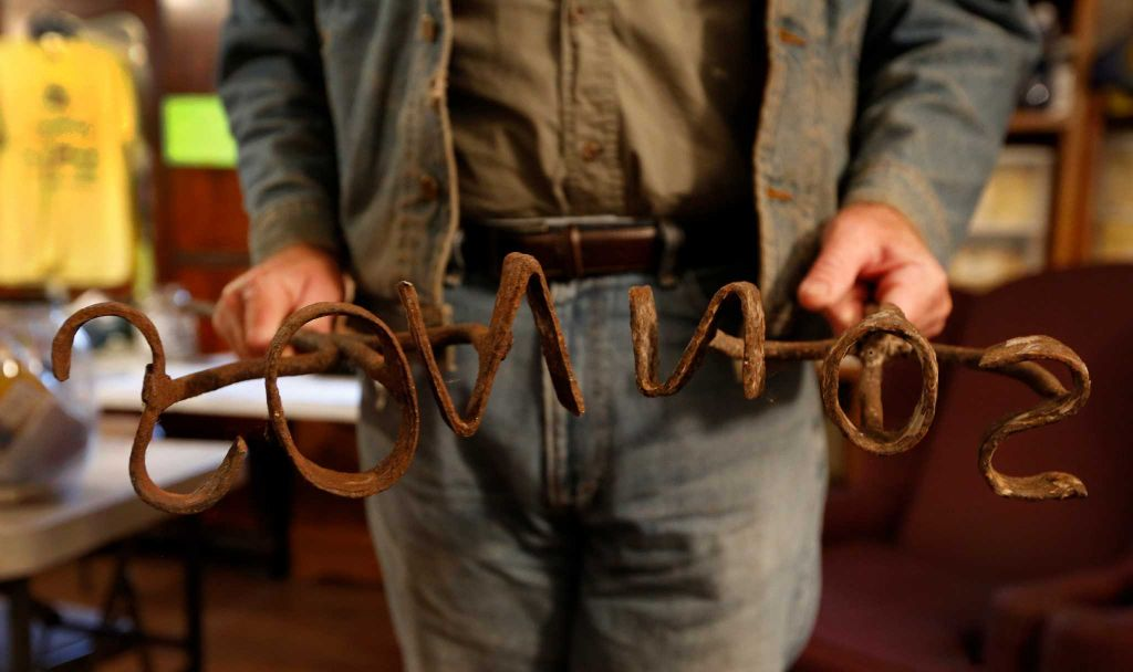 Rowdy Girl Sanctuary Tommy Sonnen, who was a cattlemen rancher, shows his Great-Grandfather's, Paul Sonnen branding irons Tuesday, Jan. 26, 2016, in Angleton. The vegan farm sanctuary is run by Renee King-Sonnen, who recently bought a herd of cattle from her husband in an effort to rescue the cows from slaughter. Now, the sanctuary is home to 48 cows, 7 chicken, a turkey, 4 horses and 4 pigs, who get to stay on the 96-acre lot in a sort of spa-retirement setting. While some of the cows were rescued locally, including the many from her husband's herd, there are new additions coming in from as far away as Florida, as King-Sonnen works to disrupt the traditional farming system that she feels is cruel to animals. ( Steve Gonzales / Houston Chronicle )